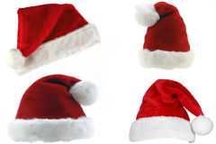 Santa Hats. A set of four Santa Claus hats on a white background stock photography