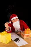 Santa having a fag Royalty Free Stock Photography