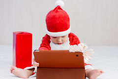 Santa helper baby boy with digital tablet Stock Photography
