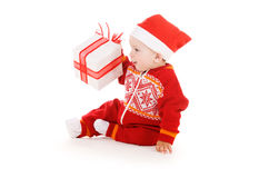 Santa helper baby with christmas gift Stock Photo