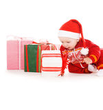 Santa helper baby with christmas gifts Royalty Free Stock Images