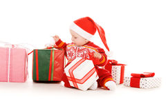 Santa helper baby with christmas gifts Royalty Free Stock Photography