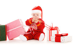 Santa helper baby with christmas gifts Royalty Free Stock Photo