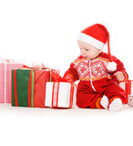 Santa helper baby with christmas gifts Stock Photography