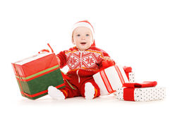 Santa helper baby with christmas gifts Royalty Free Stock Image