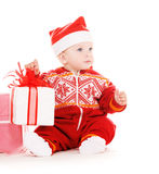 Santa helper baby with christmas gifts Stock Image