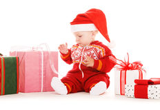 Santa helper baby with christmas gifts Stock Photo