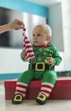 Santa helper baby with red gift Royalty Free Stock Image