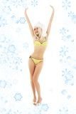 Santa helper blond on high heels with snowflakes Royalty Free Stock Photos