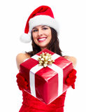 Santa helper Christmas girl with a present. Royalty Free Stock Images