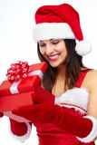 Santa helper Christmas girl with a present. Royalty Free Stock Photography