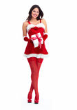 Santa helper Christmas girl with a present. Stock Images