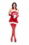 Santa helper Christmas girl with a present. Royalty Free Stock Photo