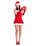 Santa helper Christmas girl with a present. Stock Photography
