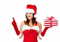 Santa helper Christmas girl with a present. Royalty Free Stock Photos