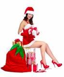 Santa helper Christmas girl with a presents. Royalty Free Stock Photos