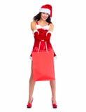Santa helper Christmas girl with shopping bags. Royalty Free Stock Photos