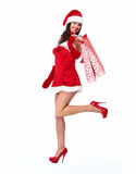 Santa helper Christmas girl with shopping bags. Stock Photo