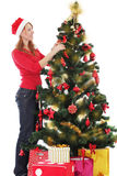 Santa helper decorating Christmas tree Royalty Free Stock Photo