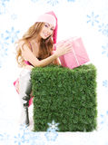 Santa helper with gift box and green cube Royalty Free Stock Photos