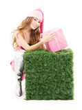 Santa helper with gift box and green cube Stock Photos