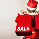 Santa helper with gifts at Christmas shopping sale Royalty Free Stock Photos