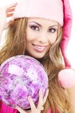 Santa helper girl with ball Stock Photography