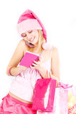 Santa helper girl calling by phone Stock Photo