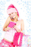 Santa helper girl calling by phone Royalty Free Stock Images