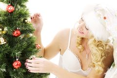 Santa helper girl decorating christmas tree Stock Photos