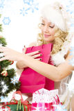 Santa helper girl decorating christmas tree Royalty Free Stock Image