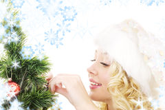Santa helper girl decorating christmas tree Stock Photography