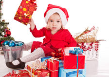 Santa helper. Girl with gift stock images