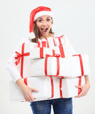 Santa helper girl with gift box Stock Image