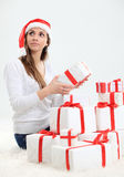Santa helper girl with gift box Royalty Free Stock Photo