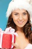Santa helper girl with gift box Stock Photos