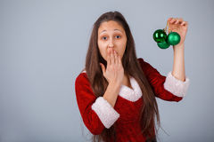 Santa helper girl with green balls Stock Image