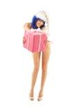 Santa helper girl on high heels #2. Santa helper girl on high heels with blue hair and pink gift box stock photography