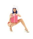 Santa helper girl on high heels #3. Santa helper girl on high heels with blue hair and pink gift box royalty free stock photos