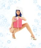 Santa helper girl on high heels with snowflakes #3 stock photography