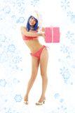 Santa helper girl on high heels with snowflakes. Santa helper girl on high heels with blue hair and pink gift box stock images