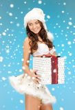 santa helper girl in lingerie with gift box Royalty Free Stock Images