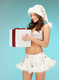 santa helper girl in lingerie with gift box Stock Image