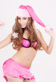 Santa helper girl with magic wand Royalty Free Stock Image