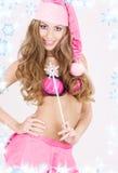 Santa helper girl with magic wand Royalty Free Stock Image