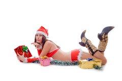 Santa helper girl sending air kiss. Over white Stock Photo