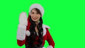 Santa helper girl sends an air kiss stock video footage