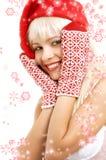Santa helper girl with snowflakes Stock Image