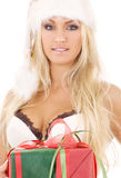 Santa helper girl in white lingerie with gift box Stock Photos
