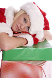 Santa helper head down on presents Stock Photography
